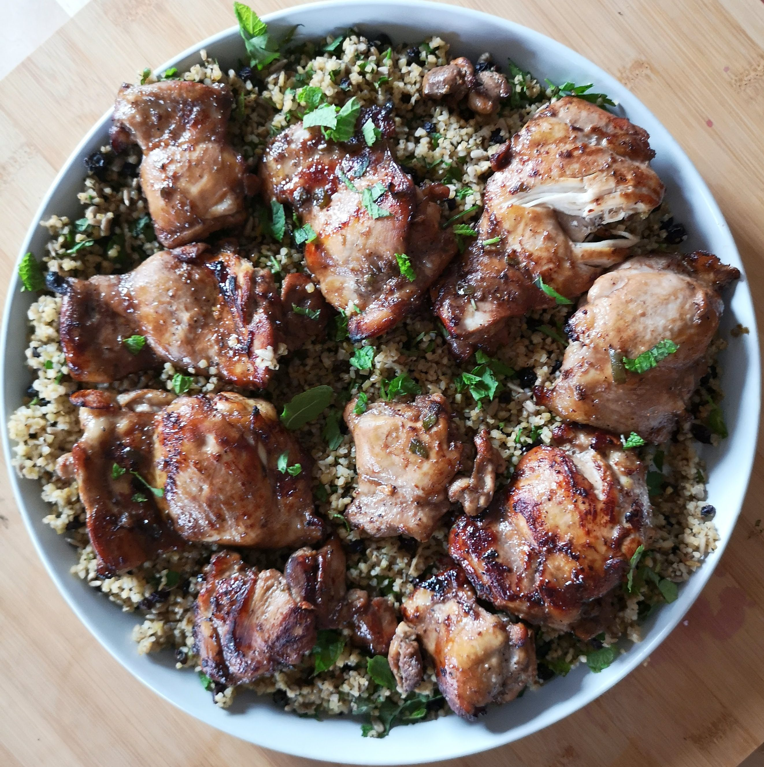 Pomegranate molasses chicken with bulgar wheat salad Honey & Co