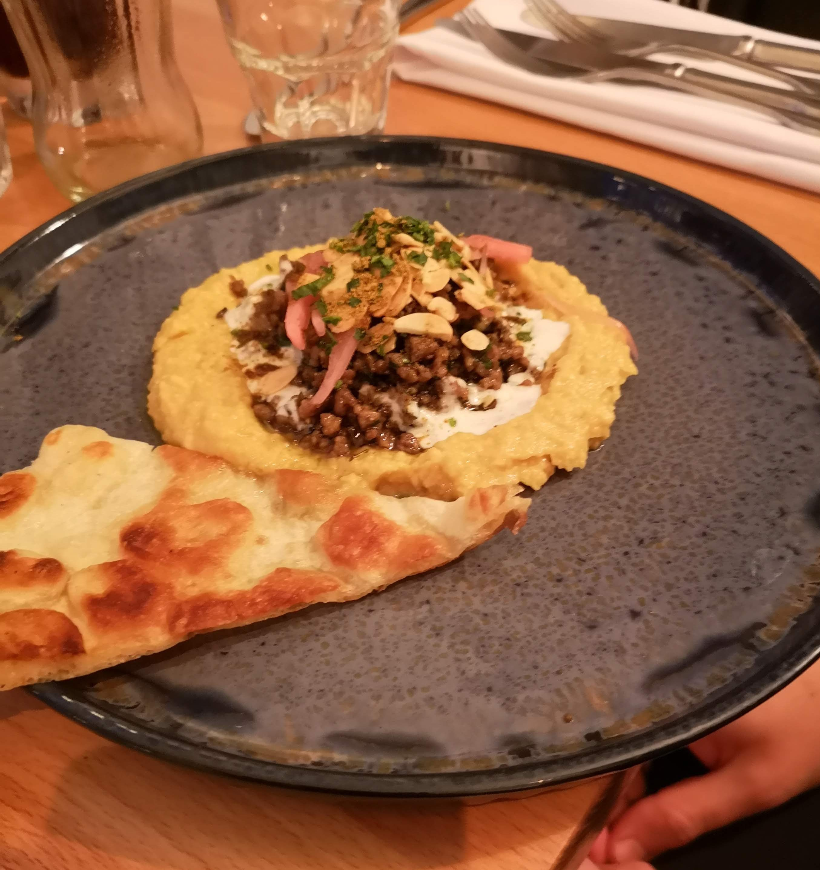 Morrocan spiced lamb, hummus, almond buttermilk on a lovely plate.